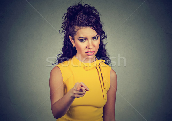 Displeased angry woman pointing finger at camera   Stock photo © ichiosea