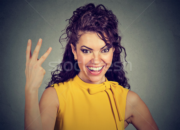Woman giving a three fingers sign with hand  Stock photo © ichiosea