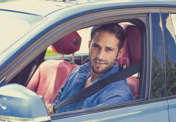 portrait of handsome guy inside car putting on a safety belt stock photo ion chiosea ichiosea. Black Bedroom Furniture Sets. Home Design Ideas