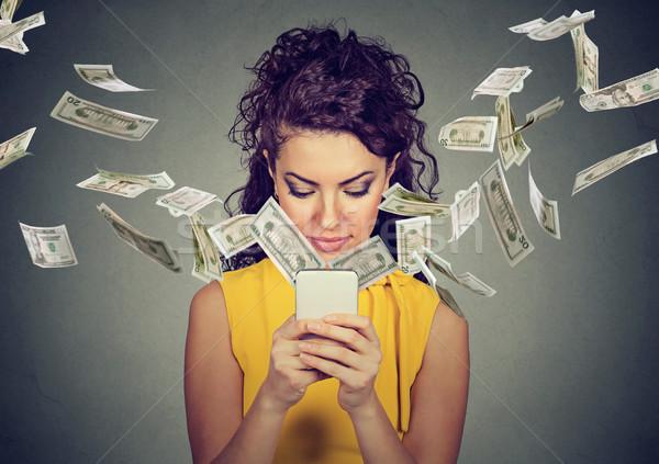 woman using smartphone making money  Stock photo © ichiosea