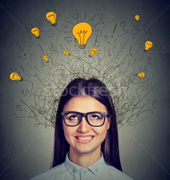 Woman with many ideas light bulbs above head looking up  Stock photo © ichiosea