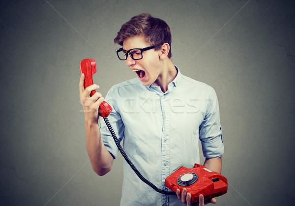 Stockfoto: Jonge · man · schreeuwen · telefoon · gezicht · bril · jongen