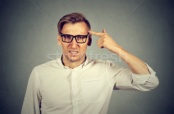 Angry mad man gesturing with finger are you crazy? Stock photo © ichiosea