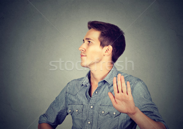 angry man with bad attitude giving talk to hand gesture  Stock photo © ichiosea