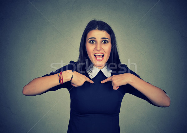 Happy woman screaming pointing fingers at herself, it is me! Stock photo © ichiosea