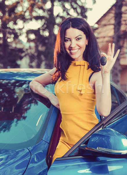woman holding keys to new car and smiling at camera on a background of a house   Stock photo © ichiosea