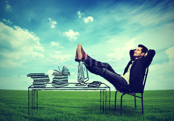 business man relaxing at his desk outdoors in the middle of a green meadow Stock photo © ichiosea