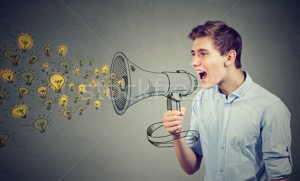Man screaming out his ideas loud in megaphone  Stock photo © ichiosea