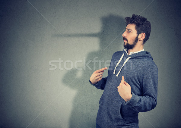Hypocritical man lying expressively Stock photo © ichiosea