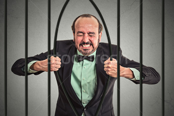 businessman bending bars of his prison  Stock photo © ichiosea