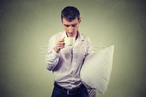 very tired, almost falling asleep business man holding a cup of coffee and pillow  Stock photo © ichiosea