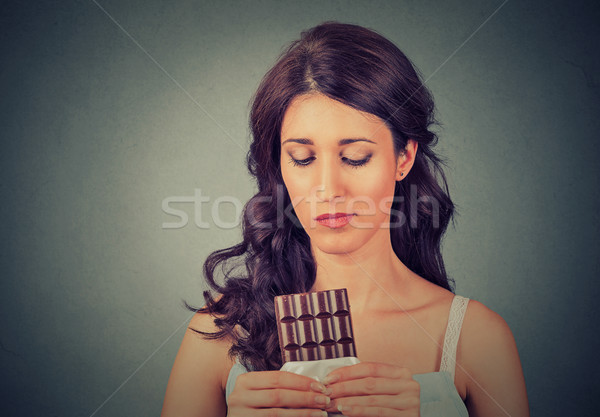 sad young woman tired of diet restrictions craving sweets chocolate Stock photo © ichiosea