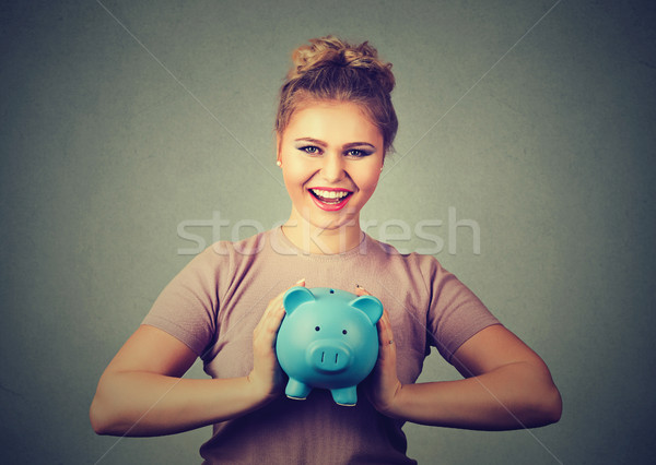 happy, smiling woman holding piggy bank. Financial savings, banking concept.  Stock photo © ichiosea