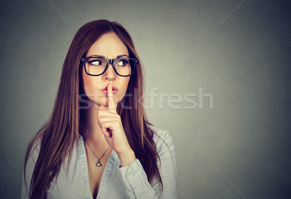 Woman saying hush be quiet with finger on lips gesture  Stock photo © ichiosea