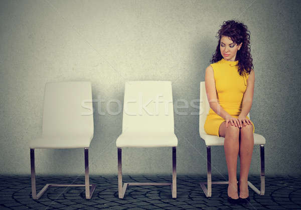 Young woman sitting on a chair waiting for job interview  Stock photo © ichiosea