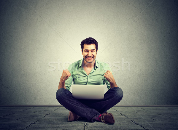 Successful  man rejoices while using a laptop Stock photo © ichiosea