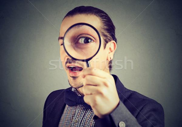 好奇心の強い 小さな ビジネスマン 見える 虫眼鏡 顔 ストックフォト © ichiosea