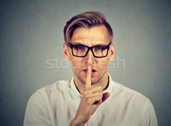 man giving Shhhh quiet silence secret. Finger on lips gesture  Stock photo © ichiosea