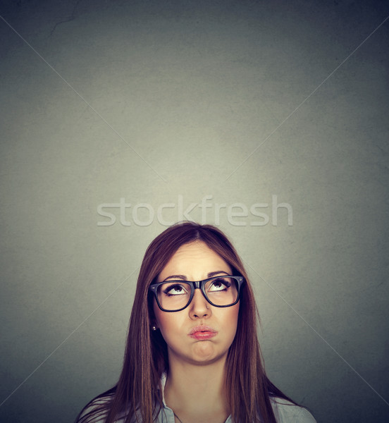 Annoyed young skeptical woman looking up  Stock photo © ichiosea