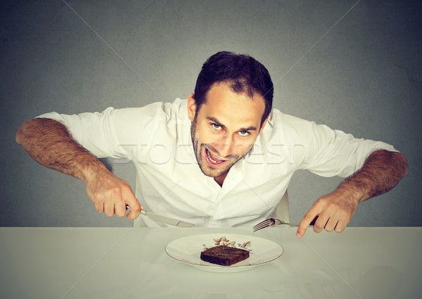 Stock photo: Hungry man craving sweet food pound cake