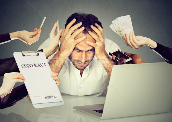 Stressed man sitting at his desk in front of computer  Stock photo © ichiosea