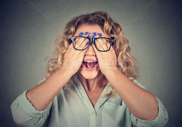Stock photo: Closeup portrait woman in glasses covering face eyes with both hands