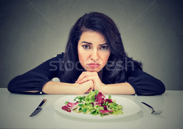 Dieting habits changes. Woman hates vegetarian diet Stock photo © ichiosea