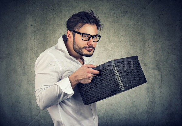 Greedy young man holding a box  Stock photo © ichiosea