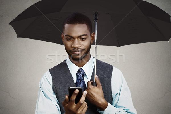 Businessman texting under umbrella  Stock photo © ichiosea