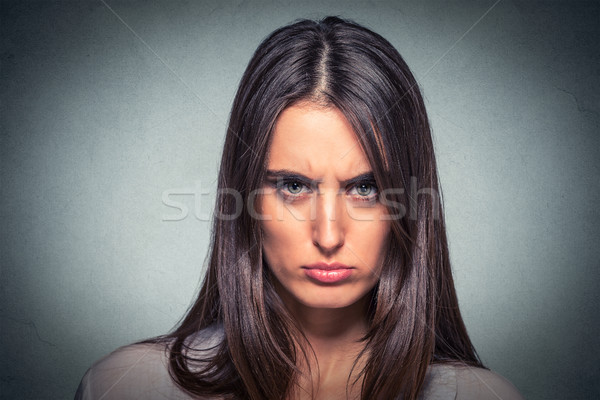 Headshot of an angry young woman  Stock photo © ichiosea