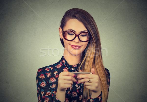 Texting on phone. Beautiful, attractive girl playing on cellphone Stock photo © ichiosea