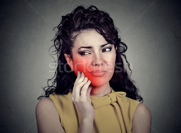 Woman with sensitive toothache crown problem suffering from pain  Stock photo © ichiosea
