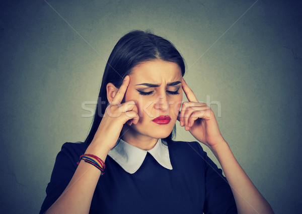 Stressed anxious young woman with headache Stock photo © ichiosea