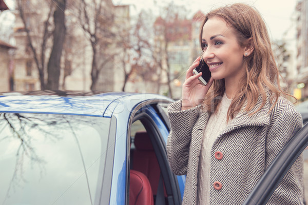 Young female driver talking on phone outside Stock photo © ichiosea