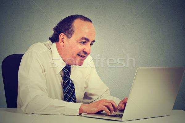 Jóképű boldog középkorú üzletember dolgozik laptop Stock fotó © ichiosea