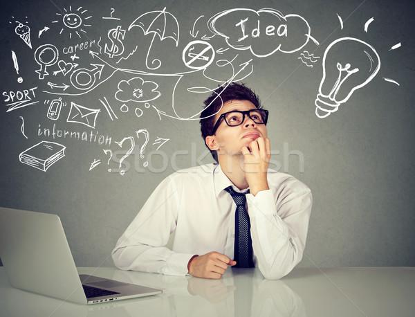 Férfi ül asztal laptop sok ötletek Stock fotó © ichiosea