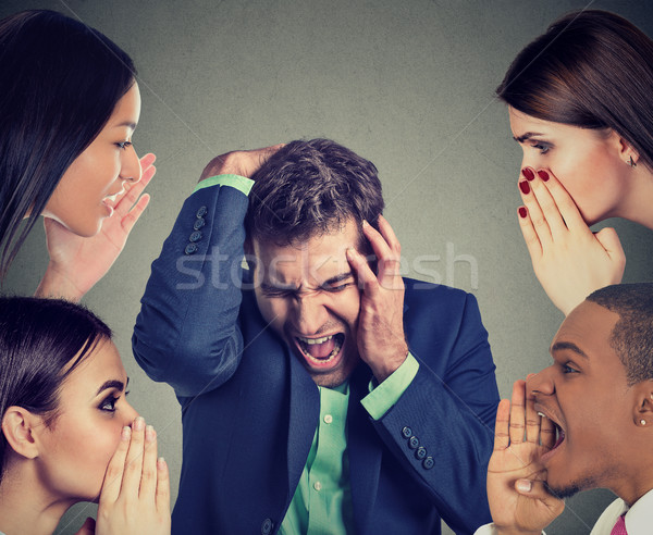 Group of people whispering to a desperate stressed business man  Stock photo © ichiosea