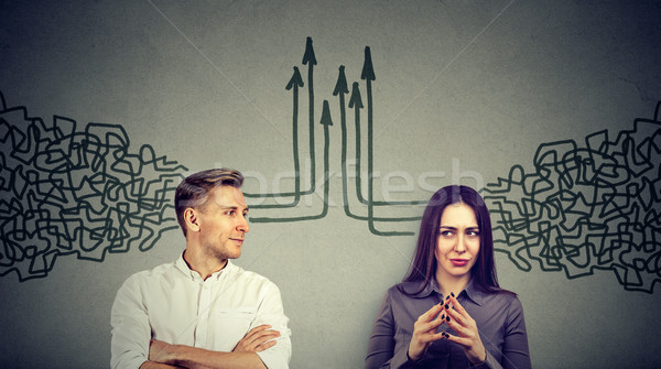Side profile of a man and woman looking at each other getting their thoughts together Stock photo © ichiosea