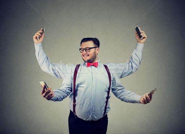 Tartalom üzletember kütyük fiatalember formális ruházat négy Stock fotó © ichiosea
