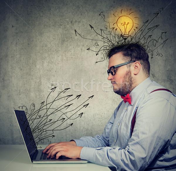 business man working on laptop has bright ideas  Stock photo © ichiosea