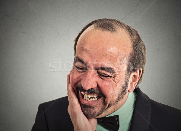 man worker touching face having bad pain suffering from tooth ache Stock photo © ichiosea