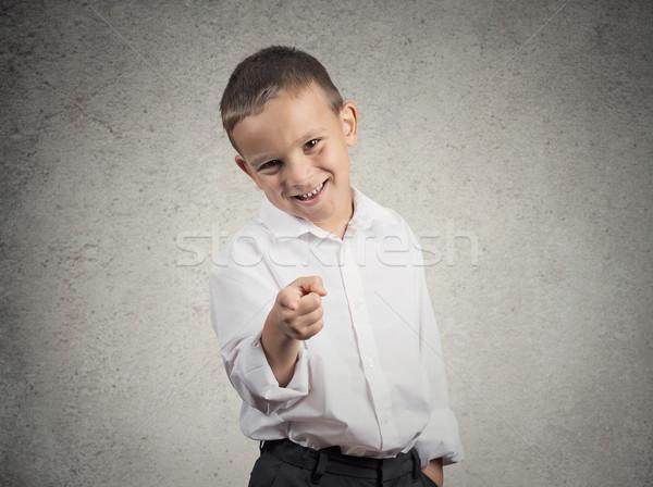 Garçon rire pointant doigt quelqu'un portrait Photo stock © ichiosea