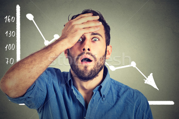 stressed shocked business man with financial market chart graphic going down Stock photo © ichiosea