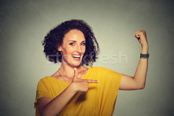 Stock photo: healthy model woman flexing muscles confident showing her strength