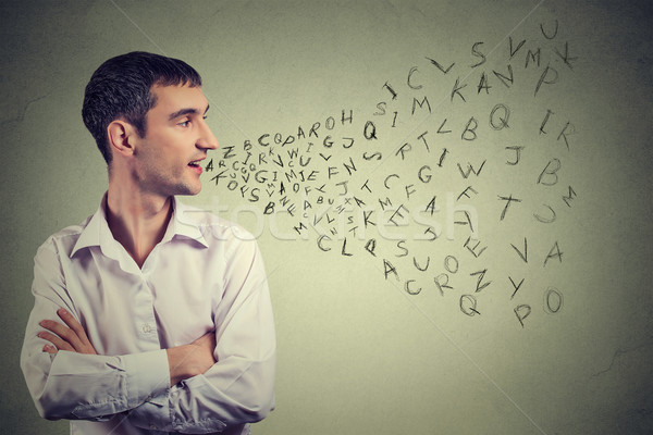 Man talking with alphabet letters coming out of his mouth. Communication, information, intelligence  Stock photo © ichiosea
