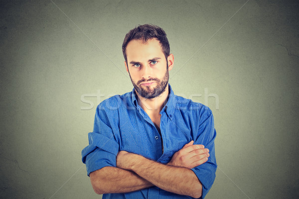 angry grumpy young man looking very displeased  Stock photo © ichiosea