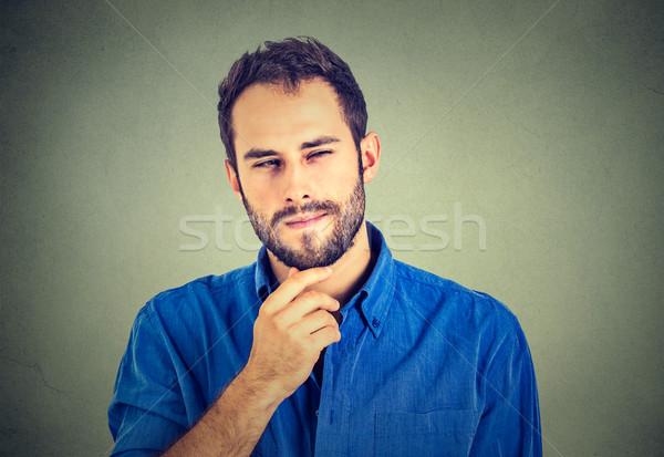 Suspicious skeptical man  Stock photo © ichiosea