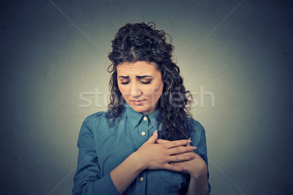 portrait young woman with breast pain touching chest Stock photo © ichiosea