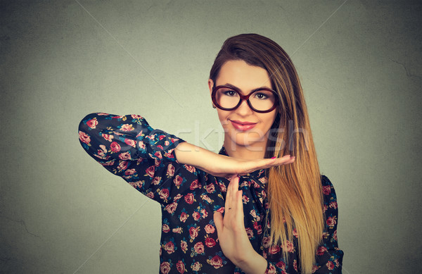 young, happy, smiling woman showing time out gesture with hands Stock photo © ichiosea