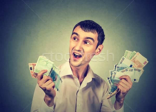 Boldog férfi pénz üzlet arc férfiak Stock fotó © ichiosea